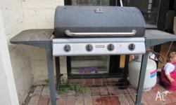 In good condition, comes with a BBQ cover and its