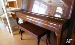 kawai upright piano with stool and metronome. this