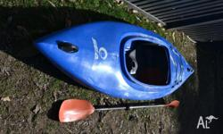 Sit-in 'Seak' kayak and paddle. Rarely used. Very good