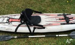 Inflatable Sevylor kayak with paddle in good condition
