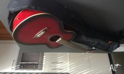 Red acoustic guitar Used but in great condition Black