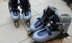 2 pairs of adjustable rollerblades that can fit kid�s