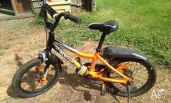 Kids orange and black 2 wheeler bike. Originally