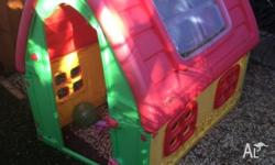 Plastic cubby house in good condition. Little front