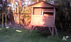 Up for sale is our kids cubby house and swing set in