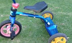 Kids cyclops trike with stand on platform at back . Pre