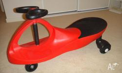 KIDS RIDE ON TOY PLASMA SWIVEL CAR with small chip on