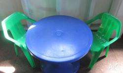 BLUE HARD PLASTIC ROUND TABLE WITH 2 x GREEN CHAIRS AND