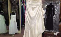 La Sposa US size 8 one shouldered satin wedding gown.