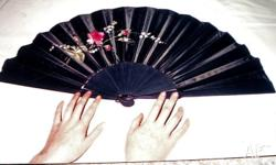 This very collectible fan is embroidered and painted on