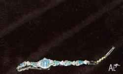 Opal and diamond ladies watch