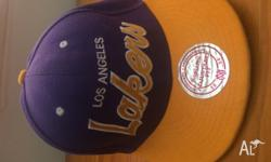 Yellow and purple Lakers Snapback hat with stickers