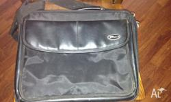 Two black lap top carry bags. Both in excellent