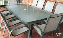 11 piece outdoor dining setting. Large glass table