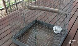 Large bird cage, has spring hinges easy to open and