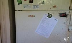 Large Fridge. OLd looking because it has been kept in