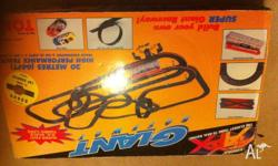 Large racing car set, comes with extra tracks and 2