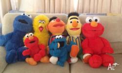 Large soft toys. Large and small Elmo laugh and talk