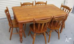 Large solid pine table and 6 colonial chairs In