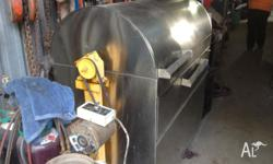 Large stainless steel spit, motorised electric