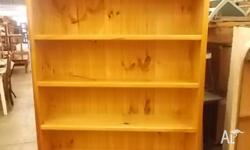 This is a large wooden bookshelf with five fixed