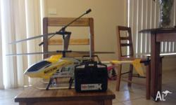 RC electric helicopter with the remote and charger.
