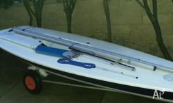 Laser sailing dinghy complete with launching trolley