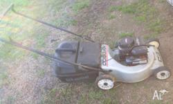 Lawn mower with catcher. Starts first pull every time.