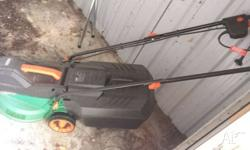 Ozito electric lawn mower, only used a few times, in