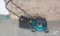 Lawn mower 4 stroke ohv motor only 2 years old in good