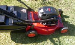 rover 4 stroke mower with catcher in good condition