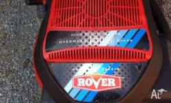 Excellent condition rover lawn mower with catcher for