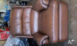 Brown leather very very comfy leather recliner. Old