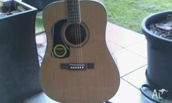 Washburn solid top acoustic guitar. One lesson with