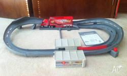 Lightning McQueen race track. Good working condition.