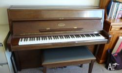 This piano is in beautiful condition. With a metal