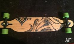 The board is a Loaded Dervish longboard, it is used but