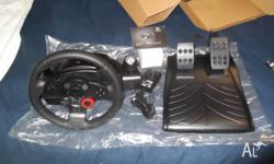 One Logitech Driving Force GT wheel and pedals, its