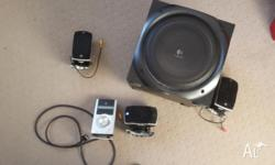 Logitech sound system. Subwolfer and 3 speakers and