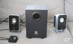 Good condition. Logitech speaker system. We don't have