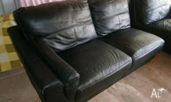 THIS IS IN GOOD USED CONDITION, BONDED LEATHER, LOOKS