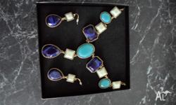 Up for Sale is a lovely necklace and earing set that
