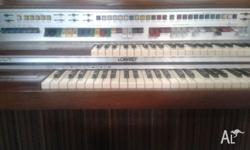 Lowrey organ for sale. Needs repair to work properly.