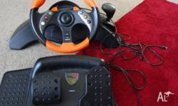 mad catz mc2 xbox steering wheel set for original xbox.