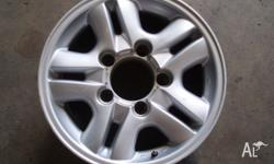 For sale is a secondhand set of mag wheels all with