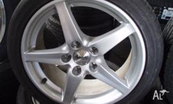 For sale is a secondhand set of 5 spoke mag wheels and