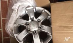 4 x 16x7 genuine mag wheels to suit 2014 Ford Ranger.