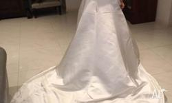 Wedding dress size 12, worn once. Magnificent ivory