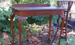 This is an elegant antique style hall table with