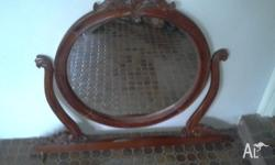 Antique hand carved mahogany miror, with bevelled edge